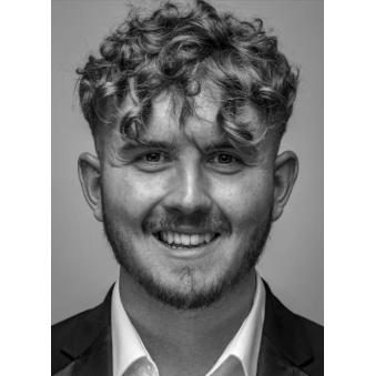 John, who has very curly hair, smiles